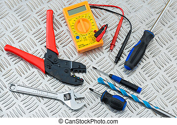 Electrician's Tools and Equipment on Steel Tread Plate -...