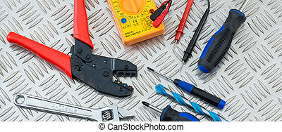 Electrician's Tools on a Metal Cross-Hatch Plate -...