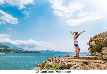 Wellbeing - Woman enjoying at beach in summer freedom with...