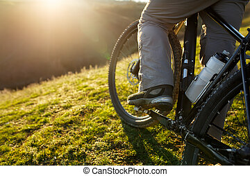 closeup of rear wheel sports mountainbike rides on the hill....