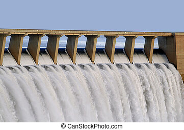 Gariep Dam - Water pouring through the sluice gates at...
