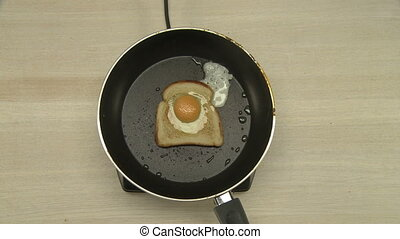 Top view of chef cooking omelet in toast - Top view of chef...