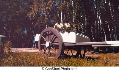 Cart with flowers in the forest