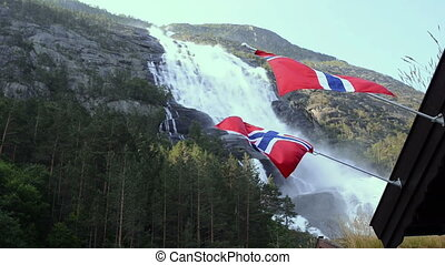 Picturesque waterfall Langfoss in Norway - Two views of...