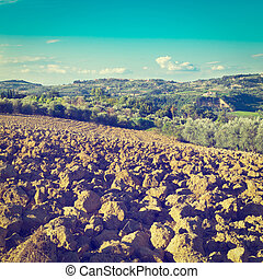 Plowed Fields - Small Medieval Italian City in Tuscany...
