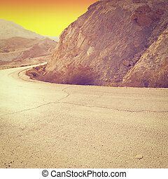 Meandering Road in Sand Hills of Judean Mountains at Sunset,...