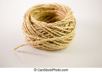 Ball of twine on white background