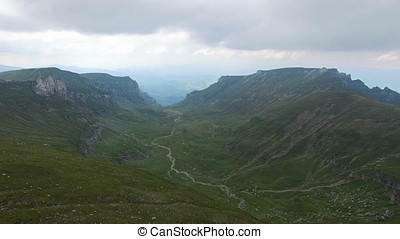 Green valley between mountains, aerial view