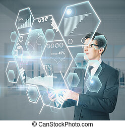 Businessman using device with charts - Man using device with...