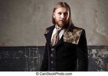 Handsome male Steam punk. Retro man in uniform, portrait...