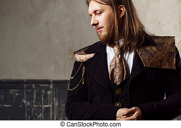 Handsome male Steam punk. Retro man in uniform, portrait...