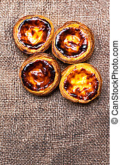 Pasteis de nata, typical Portuguese egg tart pastries close...