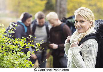 Woman Hiker With Friends Discussing In Background