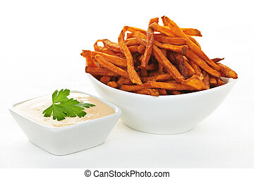 Sweet potato fries with sauce - Bowl of sweet potato or yam...