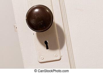 old wooden door with door knob