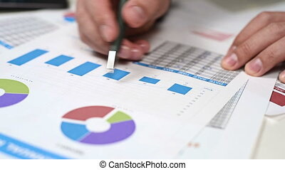 Businessman Checks Financial Report And Analyzes Stock...