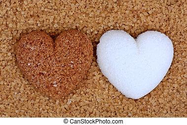 Beige sugar heart with white sugar heart on sugar background...