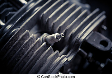 Motorcycle cylinder and spark plug detail - Color close up...