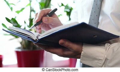 Businessman Making Notes At Office meeting. Business Concept