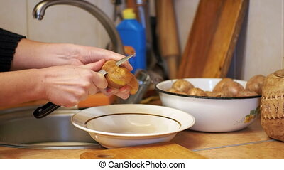 Peeling Potatoes in the Home Kitchen - Peeling Potatoes in...