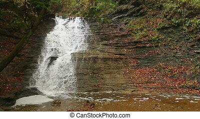 Buttermilk Falls Autumn - Loop features Buttermilk Falls, a...