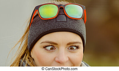 Funny girl making squinting eyes - Silly woman making funny...