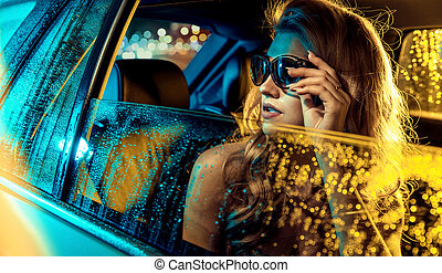 Portrait of a blond star sitting in the limousine