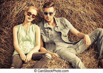 posing in haystack - Fashionable models wearing jeans...