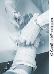 Doctor patient plaster cast - Doctor removing a plaster cast...