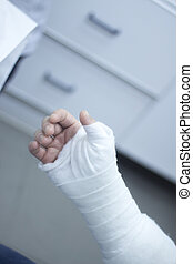 Doctor patient plaster cast - Doctor applying a plaster cast...