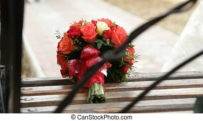 Wedding Bouquet of red roses. - Bouquet of roses on a bench