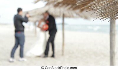 Wedding photo shoot on the beach. - Photographer taking...
