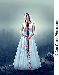 Bride in white wedding dress with bloody bat - Young bride...