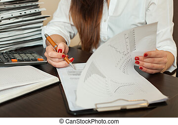 Bookkeeper signs accounting balance sheet. Accountant hands...