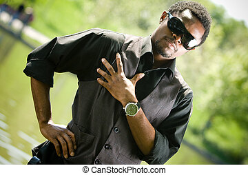 Attitude - Young black man in casual clothing Focus on watch...