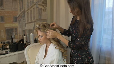 Wedding hairstyle for beautiful bride - Hair stylist makes...
