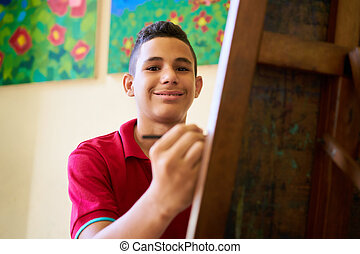Happy Hispanic Boy Student Of Art School Smiling At Camera -...