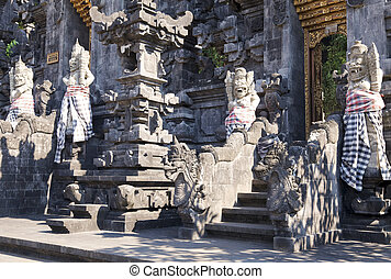 Stone Guardians at Pura Goa Lawah, Bali, Indonesia - Image...