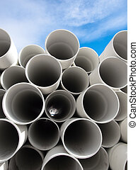 PVC Pipes - PVC pipes stacked on top of one another with...