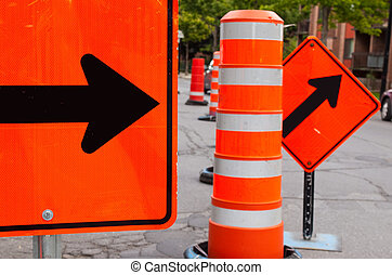 Road Work - Bright orange colored signs with black arrows on...