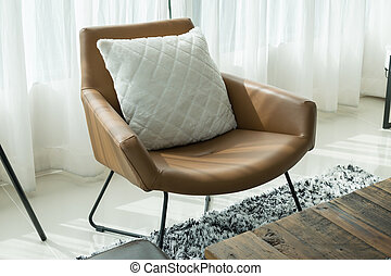 luxury living room with white pillow on brown chair