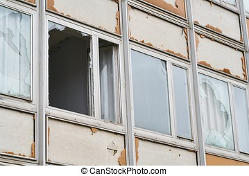 Destroyed windows of an abandoned office building in...