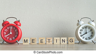 MEETING word written on wood block with red and white modern...