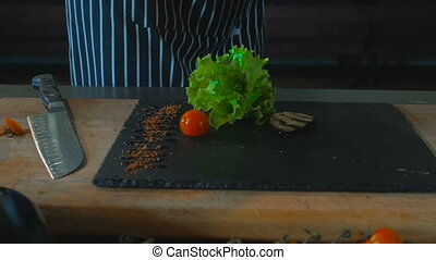Chef Hand Put Grilled Vegetables On Board Food Background -...