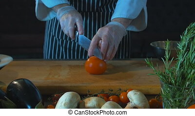 Chef Cuts Tomato On Wooden Board. Food Background