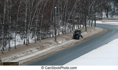 Snow clearance tractor - road service clean up the snow from...