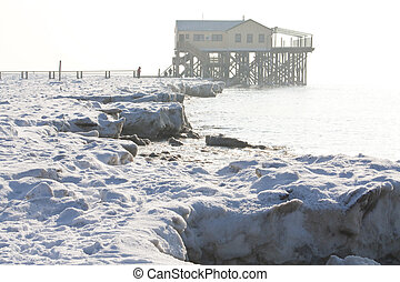 Winter in St. Peter-Ording / Germany - Winterscene with...