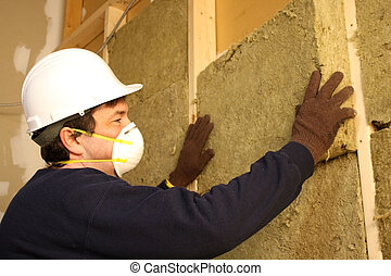 insulation installation - worker installing insulation