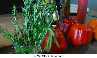Rosemary and pepper on the table. Food Background