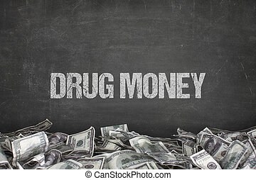 Drug money text on black background with dollar pile